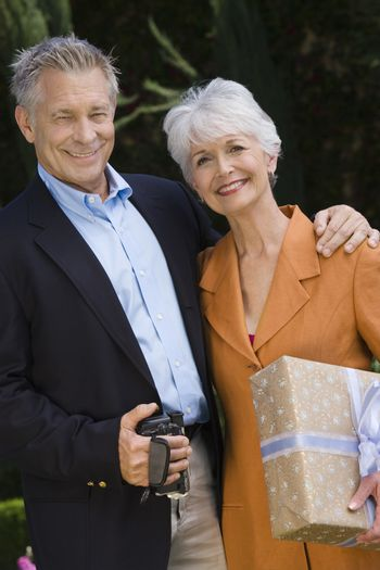 Portrait of happy senior couple standing together with arm around