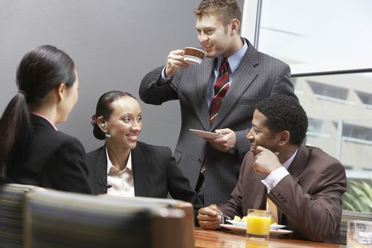 Business team having a coffee break during their meeting at office