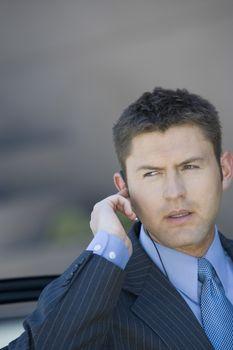 Handsome businessman in suit looking away