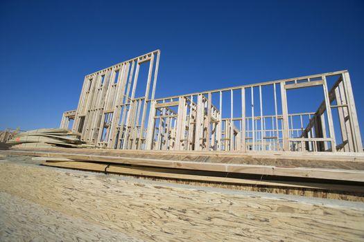 New construction framework for house against sky