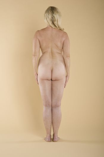 Back view of naked woman standing