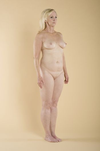 Full length of naked woman showing her curves