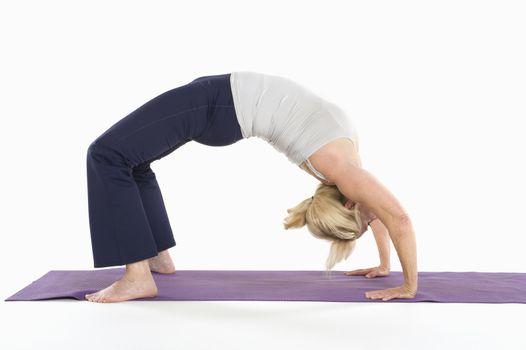 Woman in backbend yoga pose