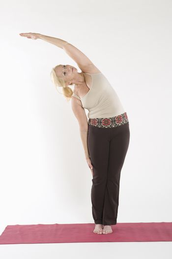 Mature woman doing stretching exercise