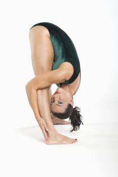Portrait of mid adult woman bending down