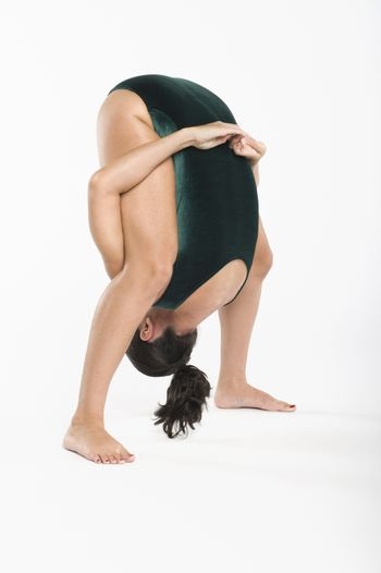 Mid adult woman bending down