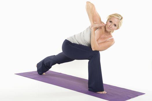 Portrait of mature woman doing yoga