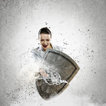 Image of businesswoman crashing with arm shield