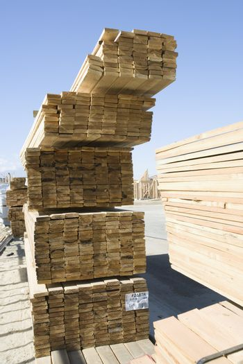Stacked lumber at residential home construction site