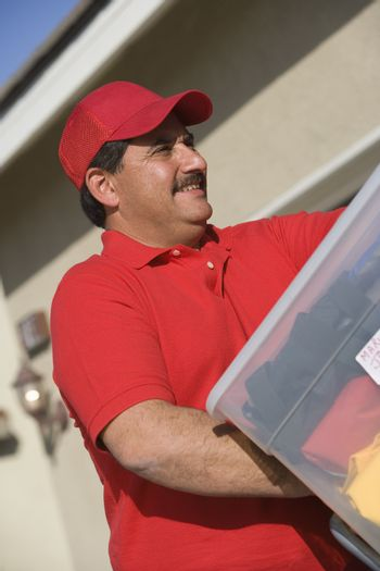 Mature man delivering package in a new house