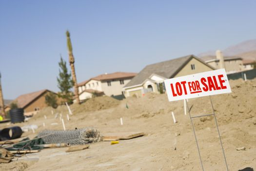 Lot for sale sign at an empty land