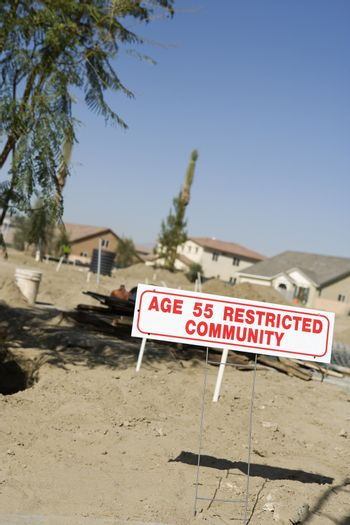 Age 55 restricted community sign at an empty land