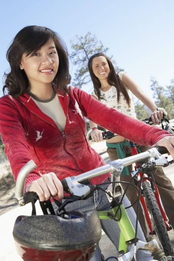 Female Friends Riding Bicycle