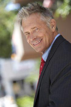 Portrait of happy successful businessman
