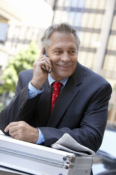 Senior businessman communicating on cellphone