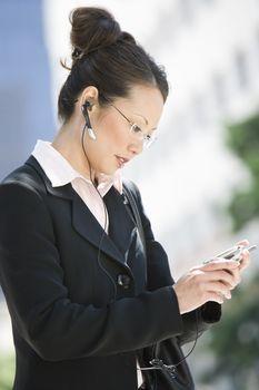 An Asian businesswoman using cellphone