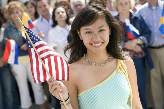 Young woman holding American flag portrait