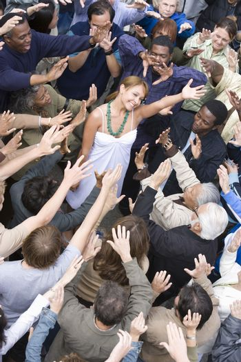 Young woman surrounded by crowd