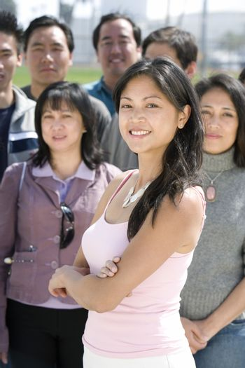 Young woman standing in crowd