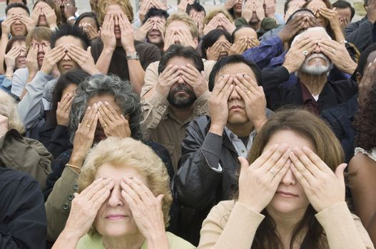 Crowd covering eyes