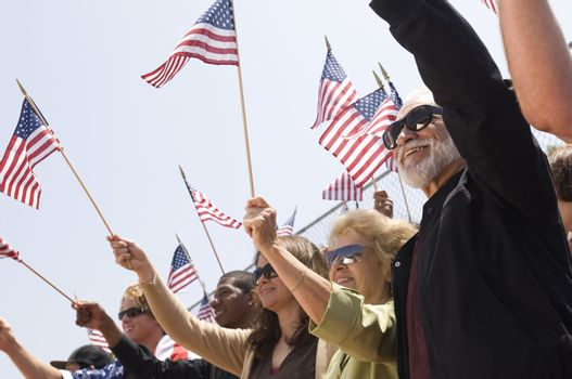People Holding American Flag During A Rally