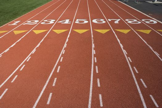 Empty running tracks with lane numbers