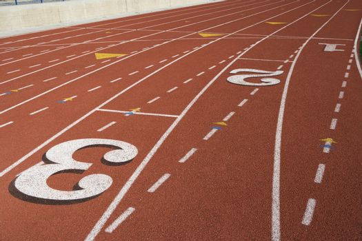 Track numbers on a running track in stadium