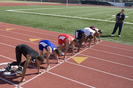 Athletes ready to run high angle view