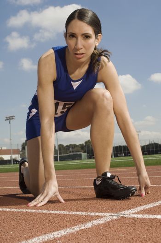 Female track athlete preparing for sprint