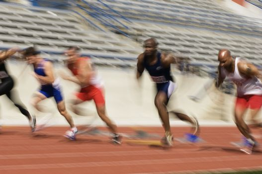 Runners running on a track