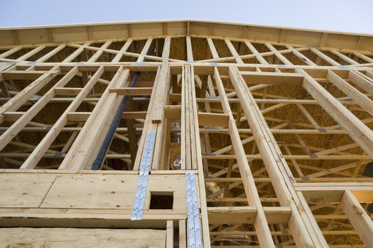 Low angle view of residential home framing under construction