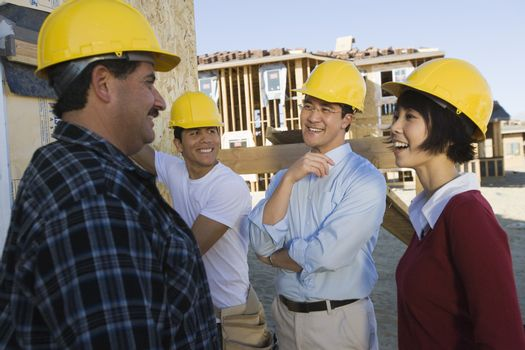 Ethnic group of architects at construction site
