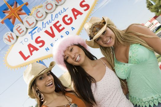 Portrait of women in front of Las Vegas welcome sign Nevada USA