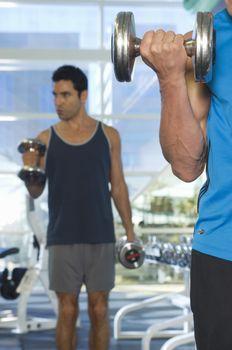 Men lifting weights at a gym