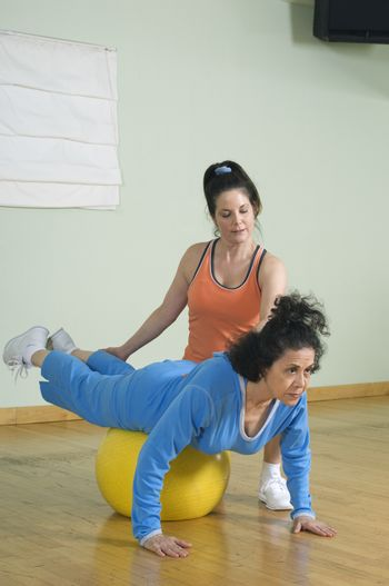 Senior woman working out with her personal trainer