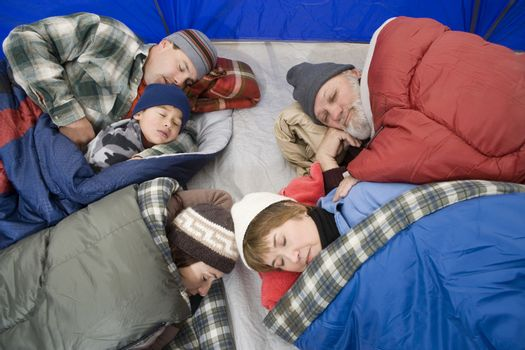 Family sleeping in tent