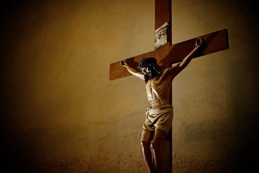 Catholic church and Jesus Christ on crucifix
