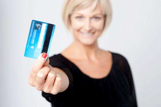 Woman displaying her credit card
