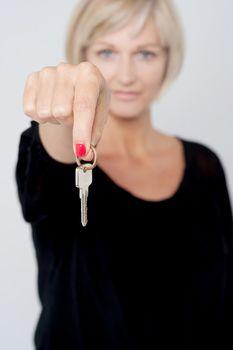 Lady displaying key to camera