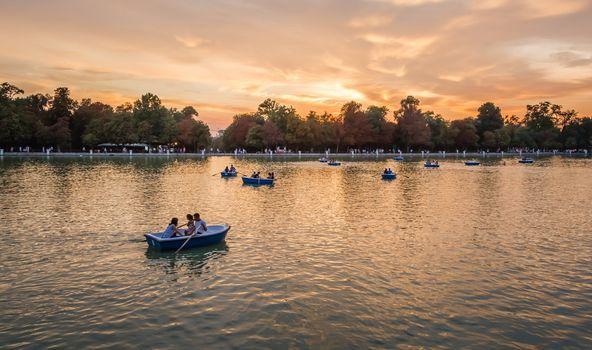 People boating in Buen Retiro park lake, Madrid