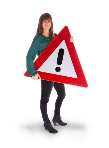 Concept of caution - Woman standing with caution sign