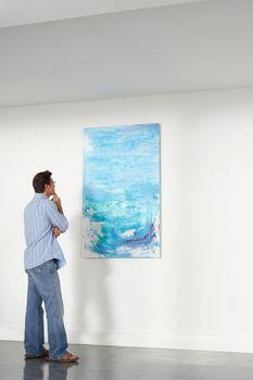 Man looking observing in art gallery