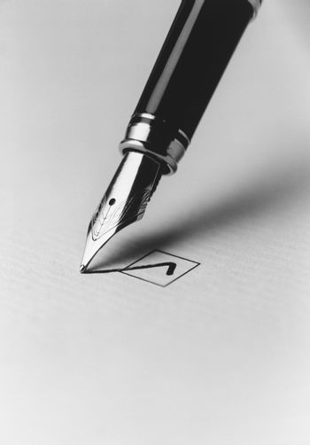 Tip of fountain pen marking checkbox (b&w) (close-up)