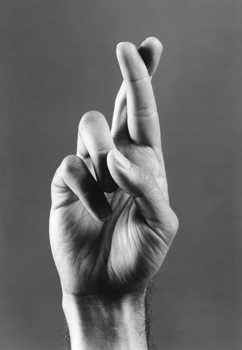 Fingers crossed (b&w) (close-up)