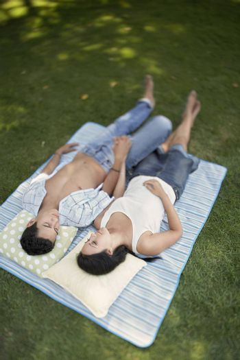 High angle view of young couple relaxing in the lawn