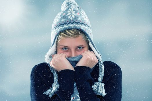 freezing young woman in snowfall