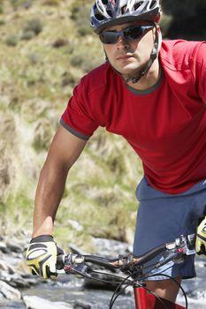 Cyclist in field
