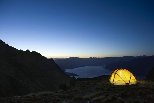 Tent By Lakeshore At Dusk