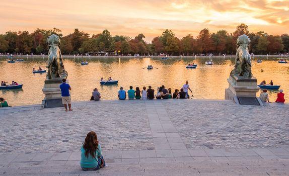 People watching sunset in Buen Retiro park Madrid