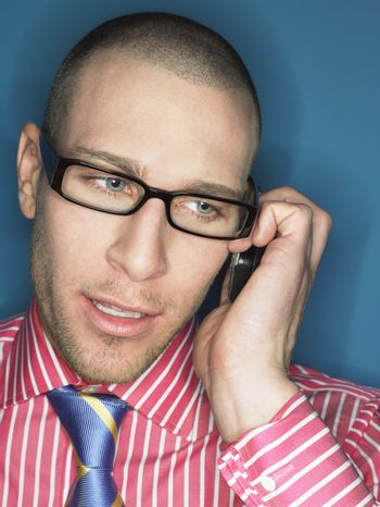 Man in glasses on cell phone head and shoulders